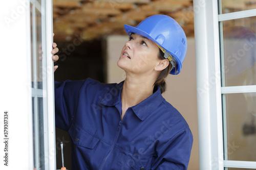 Fototapeta female worker supervising a window obraz