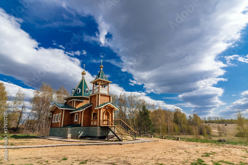 Fototapeta modern rural wooden Church of the Christian Orthodox religion in Russia