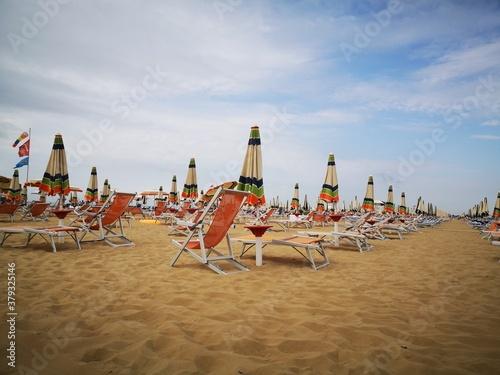 Italy Adria beach chairs and umbrellas Canvas Print
