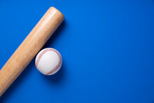 Baseball And Baseball Bat On Blue Table Background, Close Up