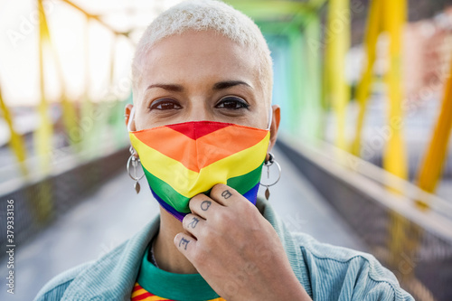 Fototapeta Young woman wearing gay pride mask - Lgbt rights, diversity, tolerance and gender identity concept obraz