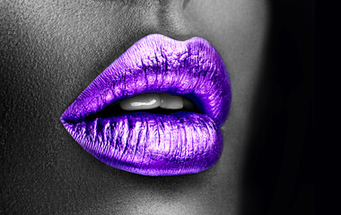 Purple lipstick closeup. Violet metal lips. Beautiful makeup. Sexy lips, bright lip gloss paint on beauty African American model girl's mouth, close-up. Lipstick. Black and white image