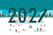 New Year Christmas Landscape. 2021 Lettering Is Decorated With Garlands. Winter Scene In Park. People Are Having Fun, Ice Skating, Walking With Their Family, Making Snowman