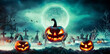 canvas print picture Jack O' Lantern On Skeleton Arms In Graveyard At Night - Halloween With Full Moon