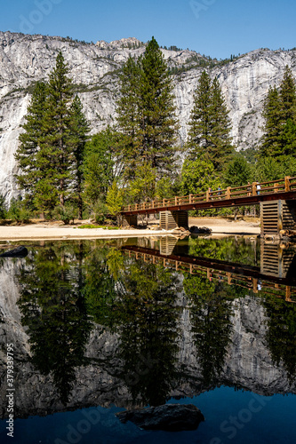 Nice view of Swinging bridge  and the landscape of Yosemite National Park during summer season , California , United States of America #379339795