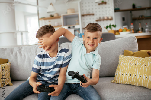 Happy brothers playing video games Canvas Print