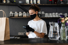 Woman Bartender Wearing Medica...
