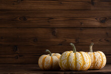 Decorative Pumpkins On Wood
