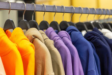 Colorful Hoodies On Hangers In...