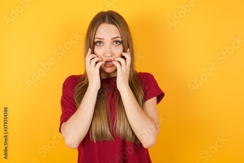 Photo Stupefied Beautiful Young beautiful caucasian girl wearing red t-shirt over isol