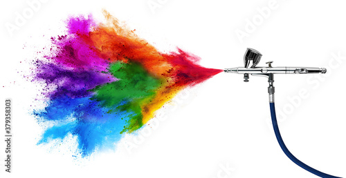 professional chrome metal airbrush acrylic color paint gun tool with colorful rainbow spray holi powder cloud explosion isolated white panorama background. industry art scale model modelling concept