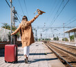 Unrecognizable female tourist walking on railway platform
