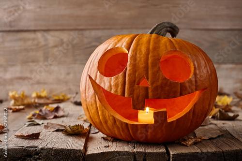 Valokuvatapetti Burning Halloween pumpkin on wooden planks