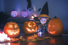 Child, Toddler Boy, Playing With Carved Pumpkin At Home On Halloween
