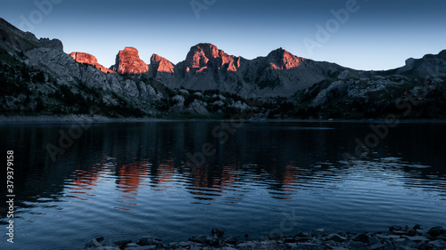 Sunset on Allos lake in the moutains