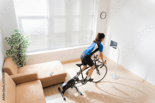Asian woman cyclist Canvas