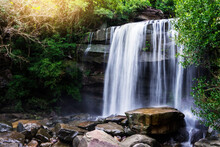 Beautiful Waterfall In Green Forest Shoot By Slow Shutter Speed To Make The Water Look Softer,Thung Na Muang Waterfall , Ubon Ratchathani In Thailand