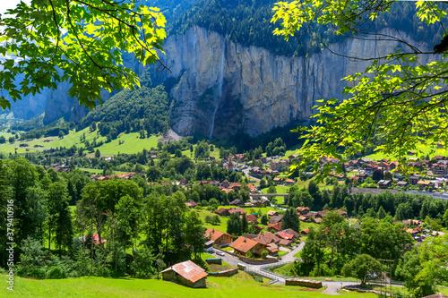 Lauterbrunnen valley, waterfall and the Lauterbrunnen Wall in Swiss Alps, Switzerland.