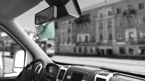 Fototapeta mask on the rearview mirror inside the car safe passenger transportation concept Taxi 3d render on white background obraz