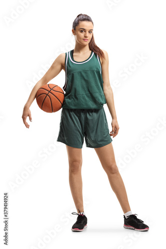 Tablou Canvas Full length portrait of a emale basketball player posing with a ball under arm
