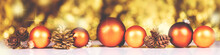 Orange Christmas Balls And Cones In Front Of Golden Background