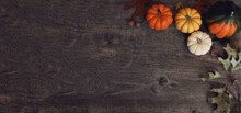 Fall Thanksgiving And Halloween Pumpkins, Leaves, Acorn Squash Over Rustic Dark Wood Table Background Shot From Directly Above, Horizontal With Copy Space