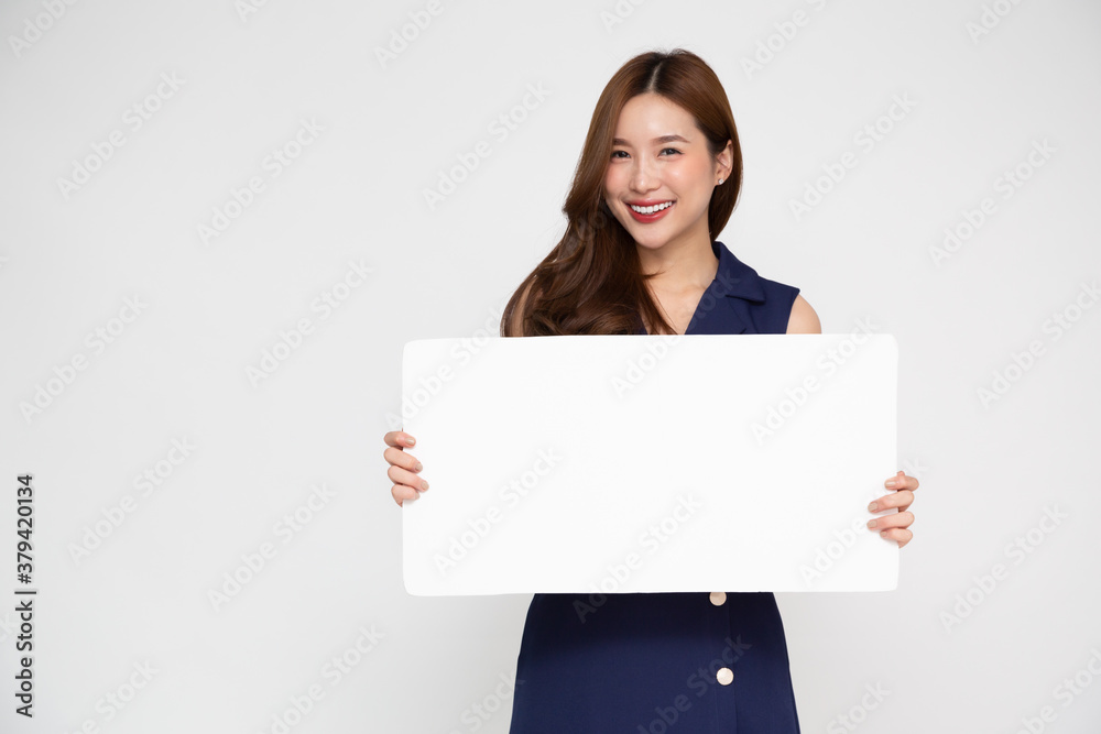 Fototapeta Young asian woman showing and holding blank white billboard isolated on white background