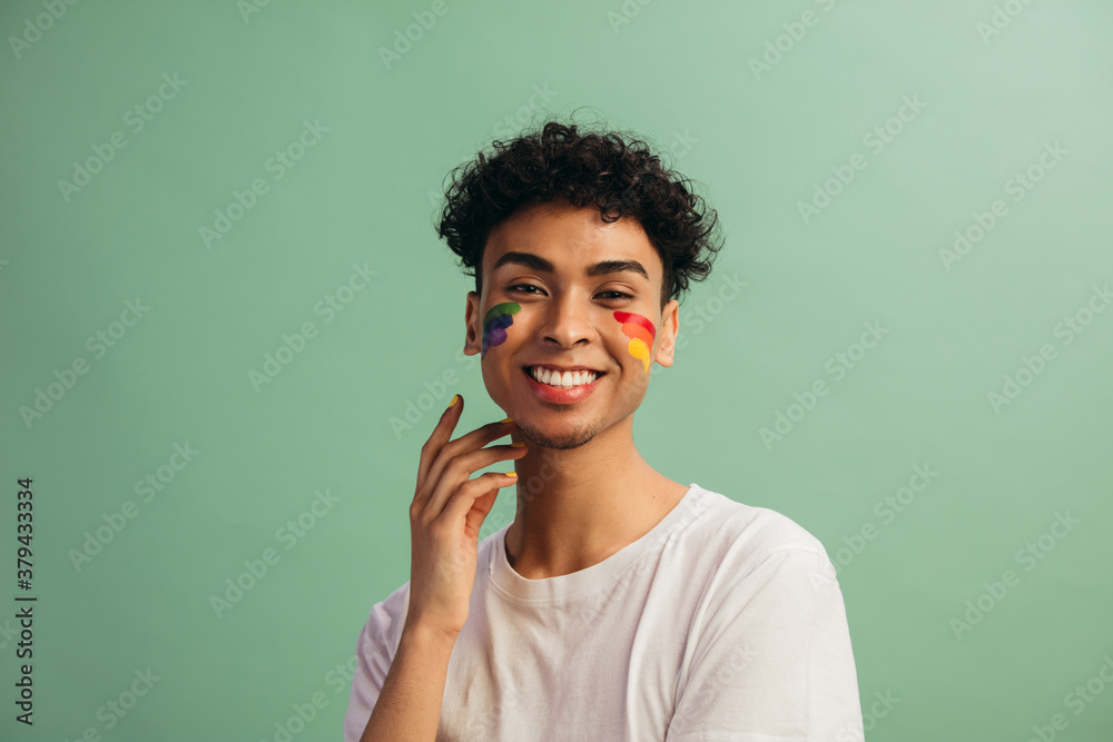 Fototapeta Man with face paint celebrates gay pride