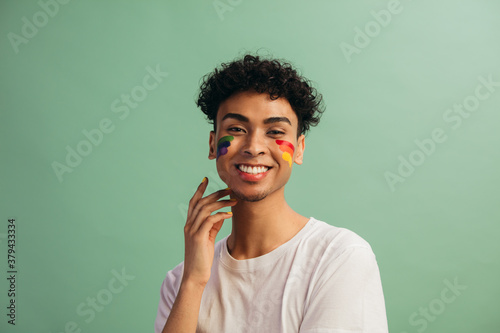 Man with face paint celebrates gay pride - 379433334