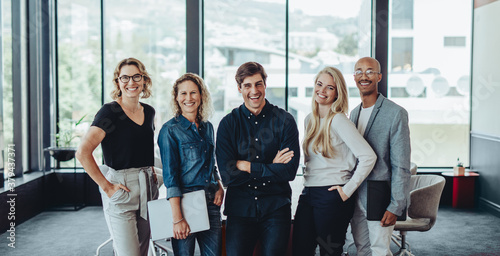 Fototapeta Multi-ethnic business team smiling in office obraz