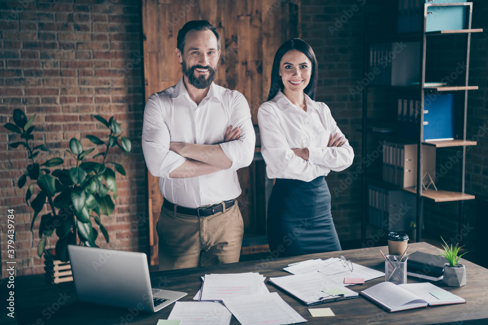 Fototapeta Photo of two colleagues assistant young lady mature boss guy man preparing report desktop full papers arms crossed confident workers team good mood formalwear office indoors