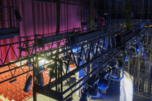 Technical Equipment At The Backstage Of Theater. Stage Spot Lighting Rigging Structure For A Musical Theater Events