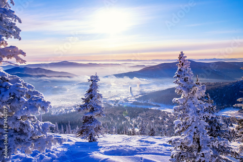 Sheregesh Kemerovo region ski resort in winter dawn sun on city, landscape on mountain and hotels, aerial top view