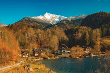 Vivid Autumn Europe Poor Village Country Side Scenic View Near Alps Mountains In Austria October Orange Clear Weather Day