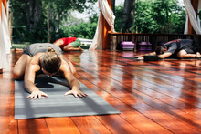 Woman In Yoga Pose During Outdoors Yoga Class