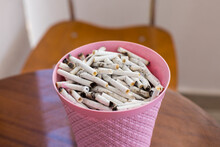 A Bucket Of Cigarette Butts