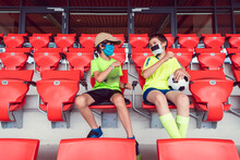 Two Boys In A Soccer Stadium D...