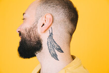 Close-up Of Neck Tattoo On Man...