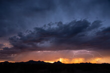 Lightning At Sunset During A Monsoon Storm