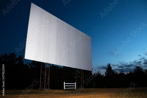 Blank white drive-in movie screen; rural outdoor setting Canvas