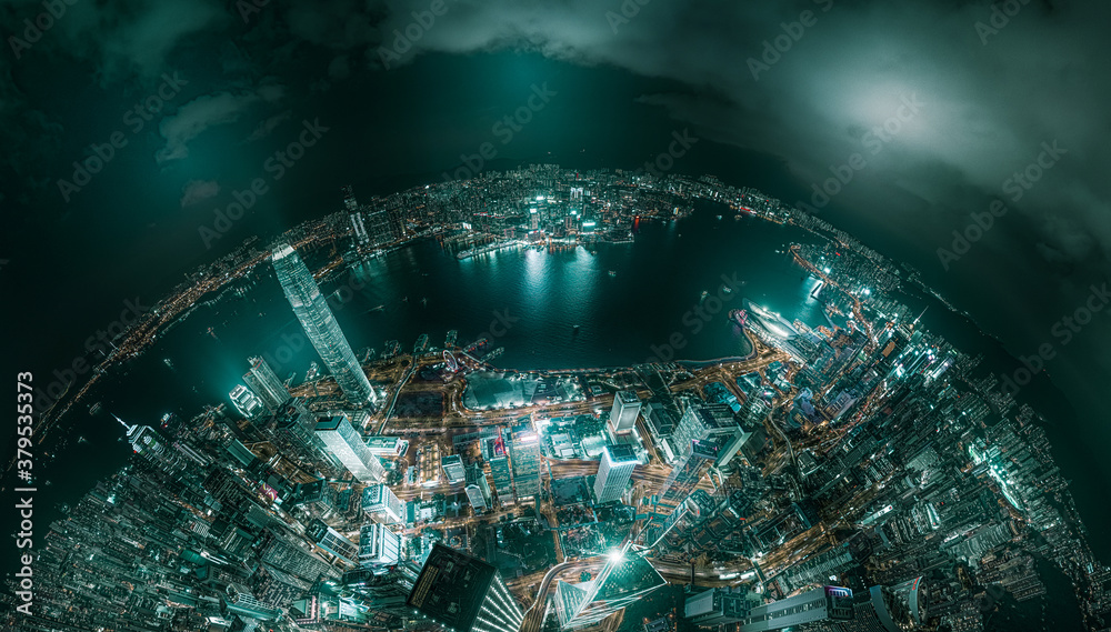 Fototapeta Top view aerial photo from flying drone of a developed metropolitan city in Hong Kong with office skyscrapers.