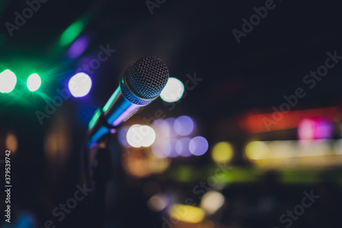 Fototapeta Close up of microphone in concert hall or conference room. obraz