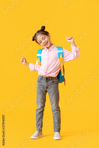 Valokuva Little schoolgirl on color background