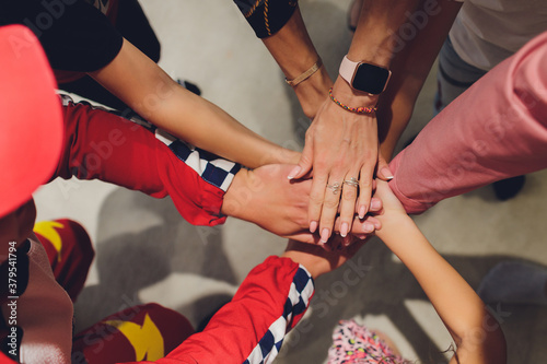Close up of high five hand gesture, symbol of common celebration or greeting, people planning to reach their goal, slap each other to start working together Canvas Print