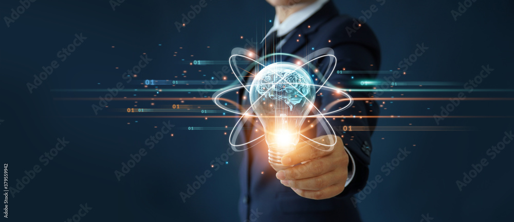 Fototapeta Businessman holding light bulb and brain inside, Idea and imagination, Creative and inspiration, Science innovation with network connection, Solution analysis and development, Innovative technology.