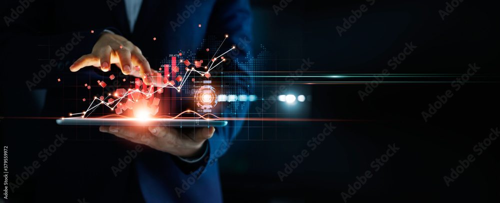 Fototapeta Businessman using tablet analyzing sales data and economic growth graph chart and block chain technology on global network on dark background.