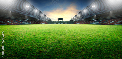 Fotografering Sunset scene illumination soccer stadium and green grass field
