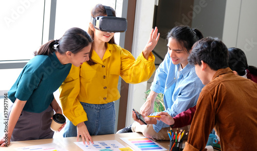 Fototapeta VR mobile phone application test, Asian woman with virtual reality glasses headset in VR experience, Asia business team developers for reality simulator smartphone app test at creative office, ui obraz