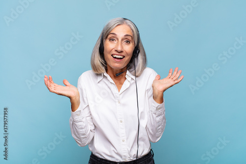 middle age woman feeling happy, excited, surprised or shocked, smiling and astonished at something unbelievable Wallpaper Mural