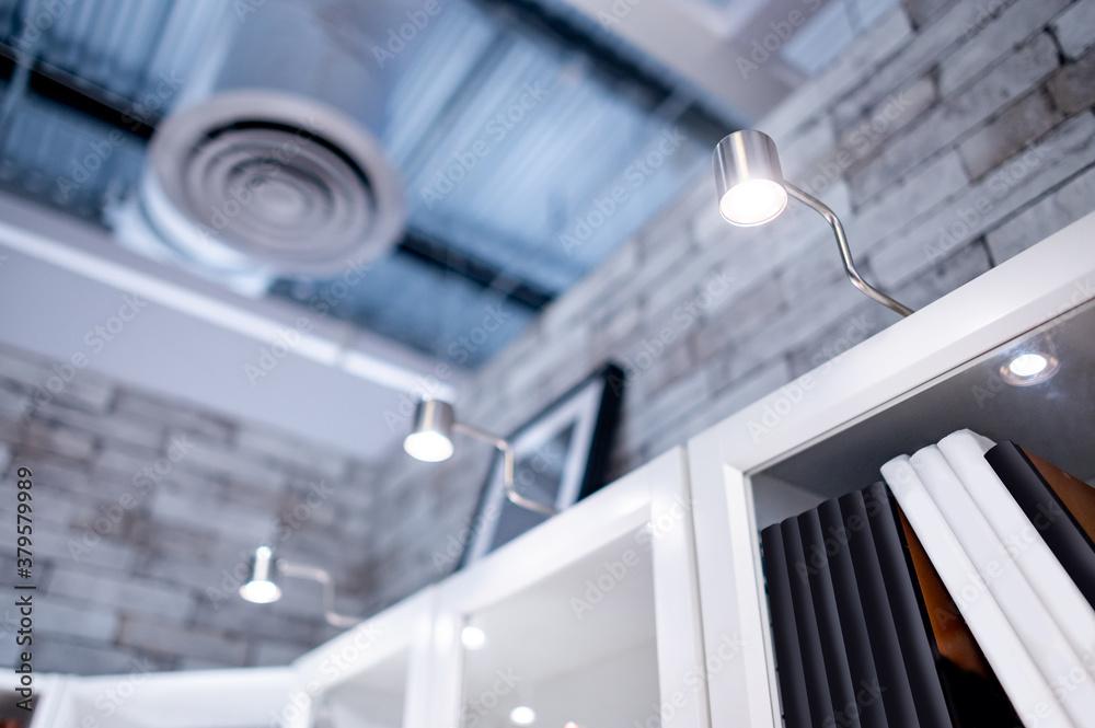 LED Cabinet lighting on the top of bookshelf. Lighting design concept